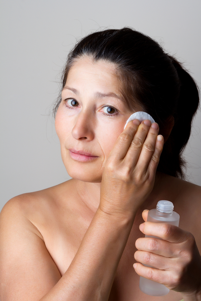 woman applying cream - anti-aging